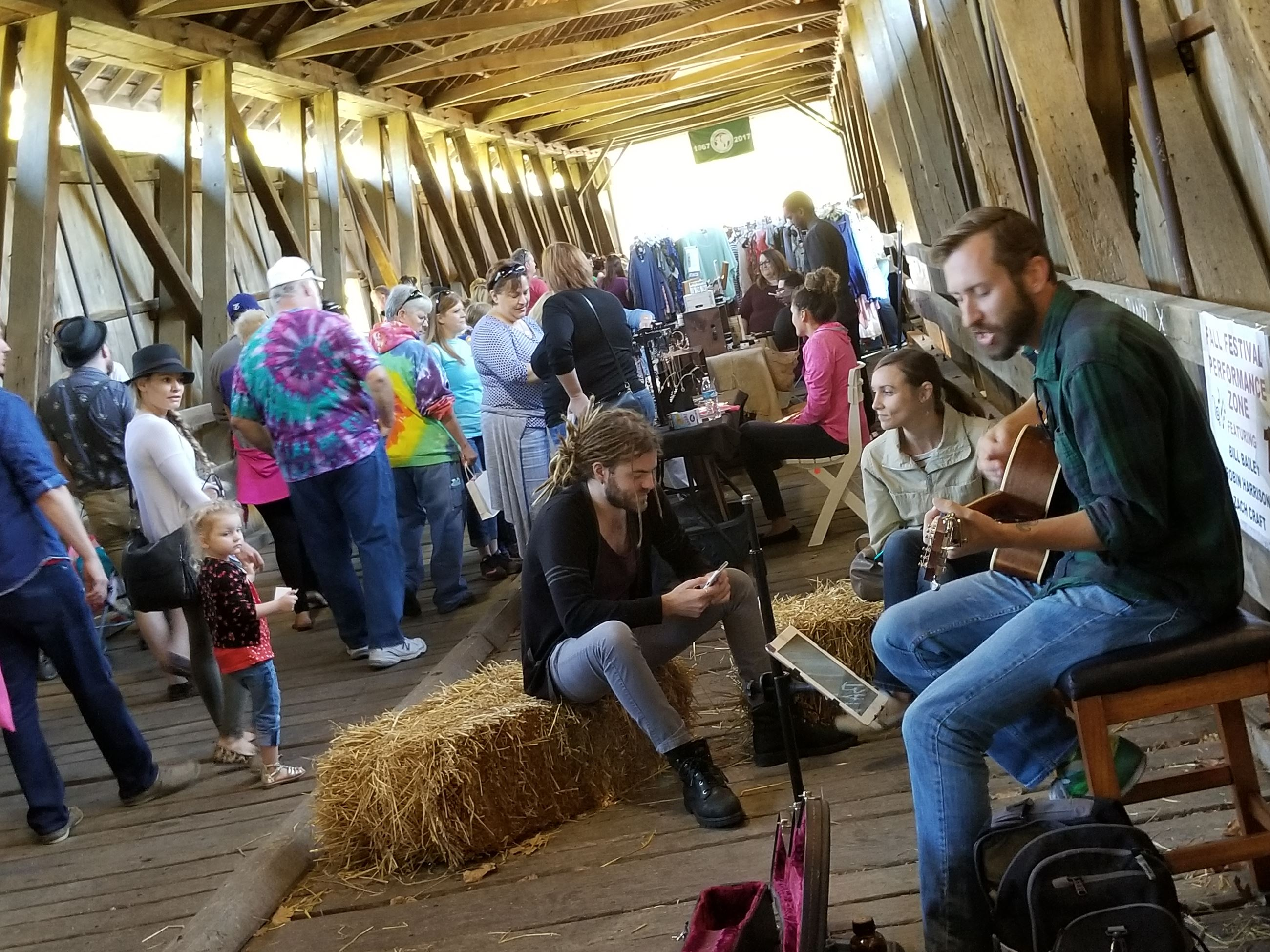 Festival goers in the bridge listening to music