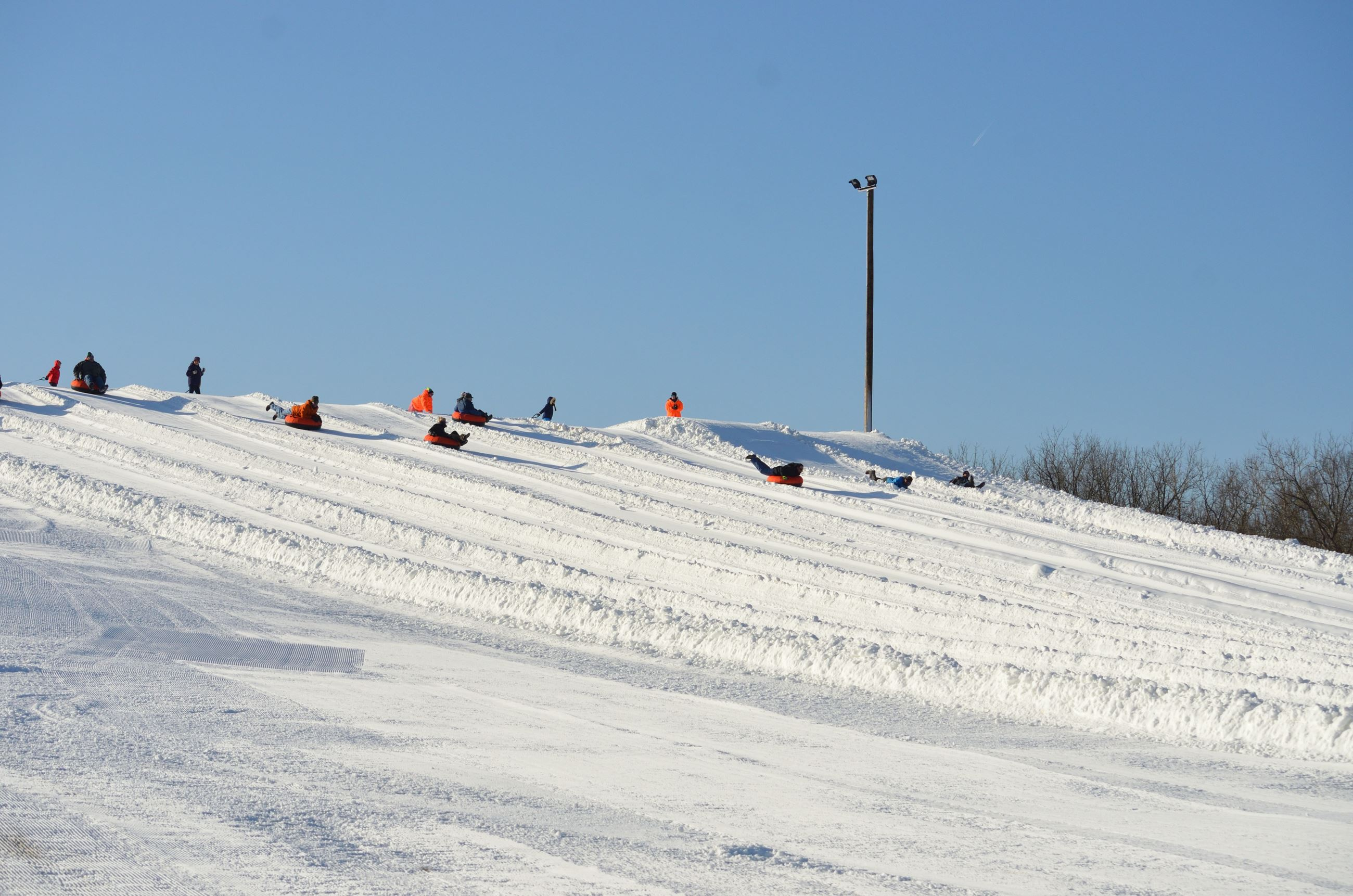 Koteewi Run Snow Tubing Hill Guests Going Down Slope