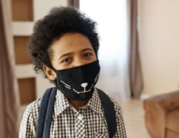 School age child wear a covid face mask